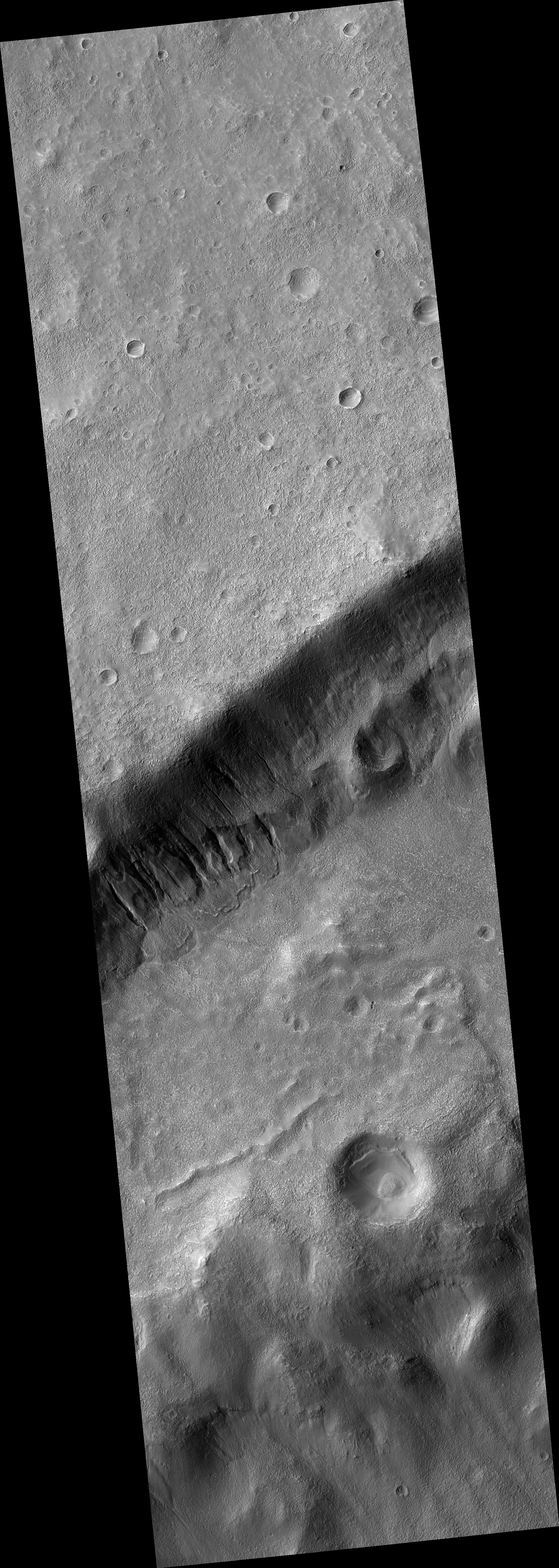 Gullies and Craters on the Floor of Newton Basin